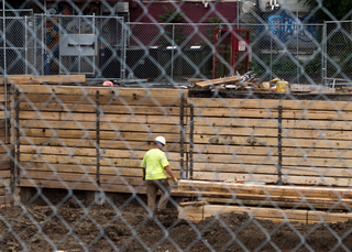 A construction worker can be seen on the South Crouse Avenue site where Hungry Chuck's and Funk 'n Waffles used to be. Photo taken July 25, 2017